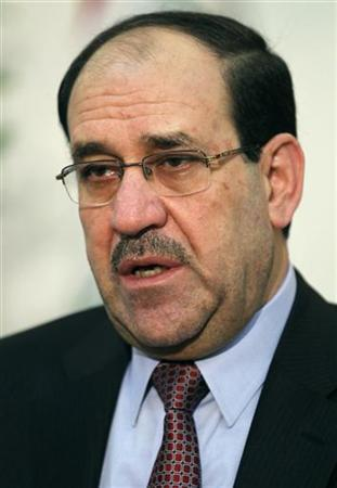 Iraq's Prime Minister Nuri al-Maliki speaks during an interview with Reuters in Baghdad October 9, 2011. REUTERS/Mohammed Ameen
