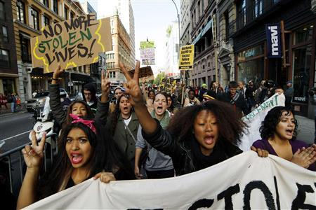 Protestors and members of Occupy Wall Street shout slogans during an annual demonstration calling for a stop to police brutality in New York October 22, 2011. REUTERS/Eduardo Munoz