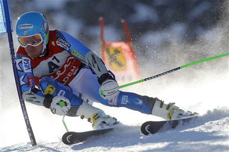 Ted Ligety from the U.S. clears a gate during the first run of the men's giant slalom World Cup race on the Rettenbach glacier in the Tyrolean ski resort of Soelden October 23, 2011. REUTERS/Dominic Ebenbichler