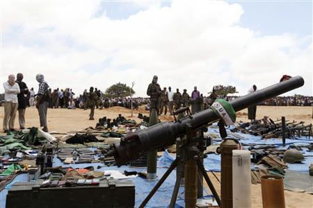 Al Shabaab Islamist militants display weapons believed to be recovered from Burundian peacekeepers from the African Union suspected to have been killed during fighting in Somalia's capital Mogadishu, October 21, 2011. REUTERS/Feisal Omar
