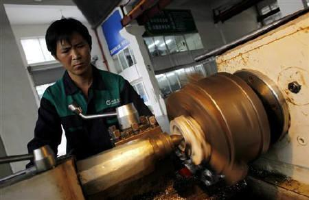 A labourer works at a valve factory in Wenzhou, Zhejiang Province October 18, 2011. REUTERS/Carlos Barria