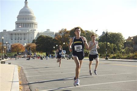 Competitors run near the U.S. Capitol Building during the Marine Corps Marathon (MCM) through Washington in this October 25, 2009 handout photo courtesy of the United States Marine Corps.    REUTERS/USMC/Cpl. Bryan G. Lett/Handout