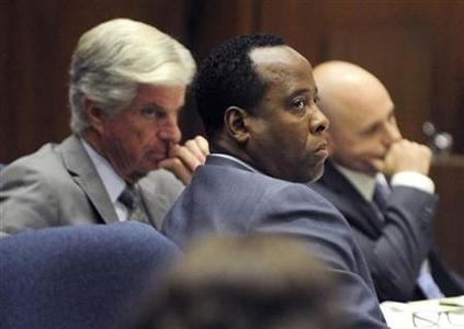 Dr. Conrad Murray (C) sits with his attorneys J. Michael Flanagan (L) and Nareg Gourjian (R) during Murray's involuntary manslaughter trial in the death of pop star Michael Jackson in Los Angeles October 24, 2011. REUTERS/Paul Buck/Pool