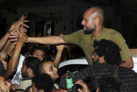 Saif Al-Islam, son of Muammar Gaddafi, greets supporters in Tripoli in this August 23, 2011 file photo. REUTERS/Paul Hackett