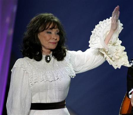 Loretta Lynn waves after performing the song ''Miss being Mrs.'' at the 39th annual Academy of Country Music Awards at the Mandalay Bay Events Center in Las Vegas, Nevada, May 26, 2004. REUTERS