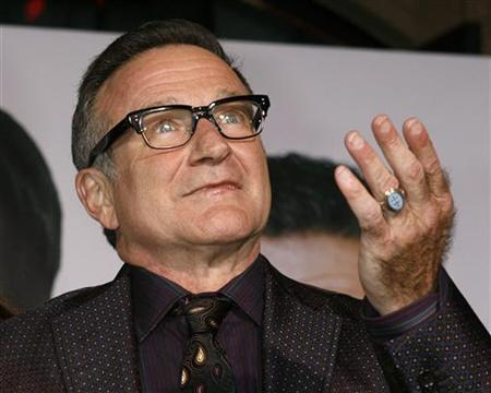 Actor Robin Williams, star of the new film ''Old Dogs'', arrives at the film's premiere in Hollywood, California November 9, 2009. REUTERS/Fred Prouser