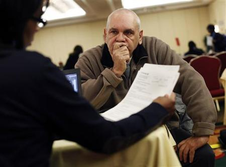 Donald Bonner, 61, who has been delinquent on his mortgage payments for three to four months, speaks with a mortgage specialist at a JPMorgan Chase foreclosure consultation event in New York,  in this March 31, 2011 file photo. MARKETS/HAIRCUT REUTERS/Shannon Stapleton/Files