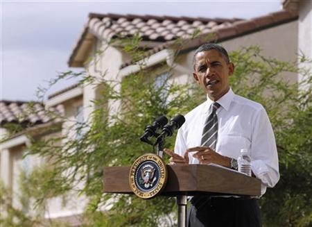 U.S. President Barack Obama speaks to the media in front of houses in a Las Vegas suburb, October 24, 2011.  REUTERS/Jason Reed