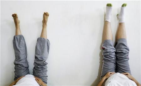 Pregnant women attend a yoga class in Madrid March 17, 2009. REUTERS/Susana Vera
