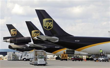 UPS employees load containers on aircraft at the World Port air hub in Louisville, Kentucky September 26, 2011.    REUTERS/John Sommers II