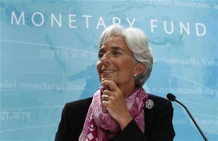 IMF managing director Christine Lagarde holds a press briefing at the International Monetary Fund headquarters in Washington July 6, 2011.  REUTERS/Kevin Lamarque