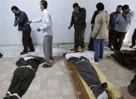Libyan people visit the body of slain Libyan leader Muammar Gaddafi inside a storage freezer in Misrata October 24, 2011. REUTERS/Thaier al-Sudani