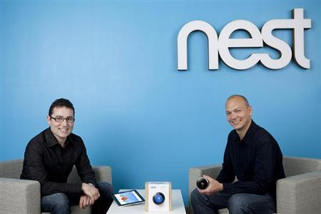 Matt Rogers (L) and Tony Fadell pose with a new thermostat gadget designed by Nest Labs in an undated handout photo. REUTERS/Nest/Handout
