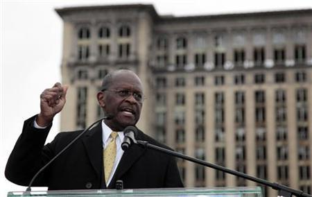 Republican Presidential candidate Herman Cain addresses the crowd during a campaign stop to launch his ''Economic opportunity zone plan'' in front of the empty, closed Michigan Central Train Station in Detroit, Michigan, October 21, 2011.    REUTERS/Rebecca Cook