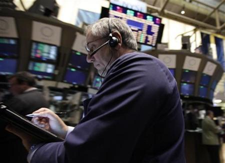 A trader works on the floor of the New York Stock Exchange October 24, 2011. REUTERS/Brendan McDermid