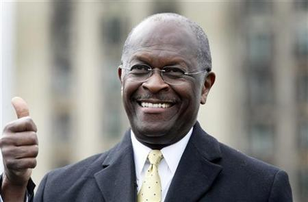 Republican Presidential candidate Herman Cain gestures to the crowd during a campaign stop to launch his ''Economic opportunity zone plan'' in front of the empty, closed Michigan Central Train Station in Detroit, Michigan, October 21, 2011.    REUTERS/Rebecca Cook