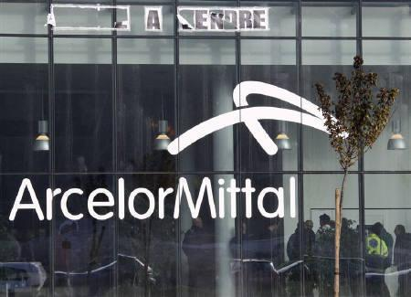 ArcelorMittal steel workers wait inside the company's regional headquarters in Flemalle, near Liege October 13, 2011. REUTERS/Yves Herman