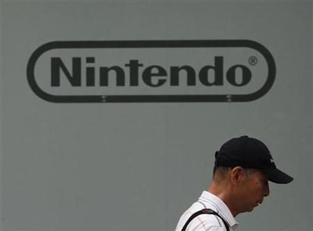 A man walks past Nintendo Co Ltd's showroom in Tokyo July 28, 2011.  REUTERS/Toru Hanai