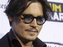 "<p>Actor Johnny Depp poses at the premiere of his new film ""The Rum Diary"" hosted by Film Independent at the Los Angeles County Museum of Art (LACMA) in Los Angeles October 13, 2011. REUTERS/Fred Prouser</p>"
