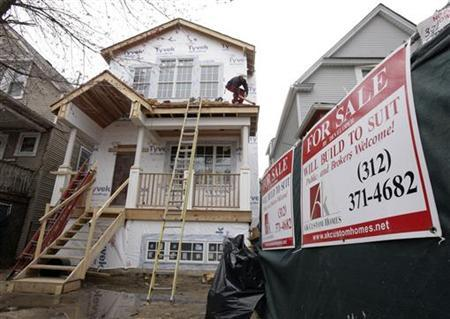 A man works on a new home being built by developer Azeem Kahn in Chicago April 21, 2011.   REUTERS/John Gress