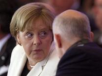 Канцлер Германии Ангела Меркель и премьер-министр Греции Георгиос Папандреу на встрече в Берлине, 27 сентября 2011 г.Требования немецкого правительства по ужесточению мер бюджетного дефицита Греции пробудили историческую враждебность и возродили параллели с массовым разрушением страны нацистской Германией 65 лет назад. REUTERS/Tobias Schwarz