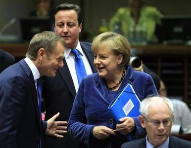 Poland's Prime Minister Donald Tusk (L), Britain's Prime Minister David Cameron (2ndL), Germany's Chancellor Angela Merkel (2ndR) and European Council President Herman Van Rompuy (R) attend an European Union summit in Brussels, October 26, 2011. The European Union's leaders are meeting to work out a comprehensive deal to resolve the euro zone debt crisis and find a way to give the region's bailout fund greater firepower.    REUTERS/Yves Herman