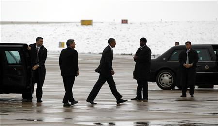 U.S. President Barack Obama steps out of his limousine into the snow at Buckley Air Force Base near Denver, October 26, 2011.  REUTERS/Jason Reed