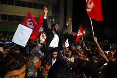 Supporters of the Islamist Ennahda movement celebrate outside Ennahda's headquarters in Tunis October 25, 2011.  REUTERS/Anis Mili