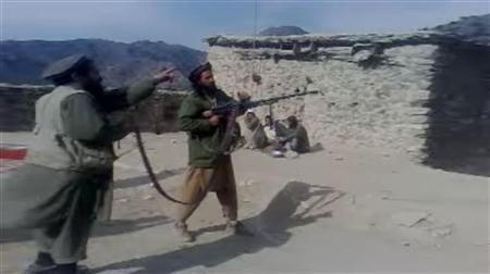 In this undated image taken from a video recording provided by the Pakistan Taliban, men are seen firing a weapon in an undisclosed location in Pakistan's northwest tribal region.   REUTERS/Handout