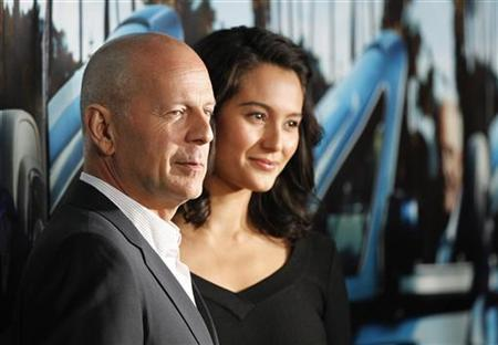 Actor Bruce Willis and his wife Emma Heming pose at the premiere of the HBO documentary ''His Way'', which portrays the life of legendary movie producer Jerry Weintraub, at the Paramount theatre in Los Angeles March 22, 2011.  REUTERS/Mario Anzuoni