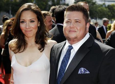 Chaz Bono (R) and Jennifer Elia arrive at the 2011 Primetime Creative Arts Emmy Awards in Los Angeles September 10, 2011. REUTERS/Danny Moloshok