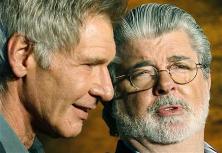 Actor Harrison Ford (L) and executive producer George Lucas chat as they arrive for the Japan premiere for ''Indiana Jones and the Kingdom of the Crystal Skull'' in Tokyo June 5, 2008.  REUTERS/Yuriko Nakao