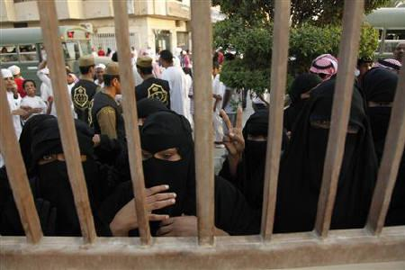 Saudi women look through the main fence of Al Oud cemetery during the burial of Saudi Crown Prince Sultan bin Abdulaziz al-Saud, who died in New York on Saturday, in Riyadh October 25, 2011. REUTERS/Fahad Shadeed