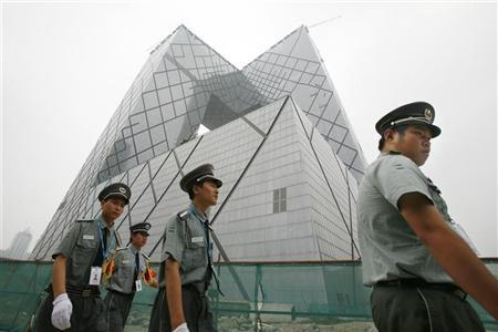 Chinese security guards patrol near the China Central Television (CCTV) headquarters in Beijing July 30, 2008. REUTERS/Claro Cortes IV