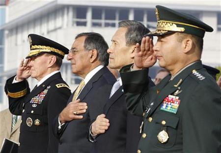 U.S. Defense Secretary Leon Panetta (2nd L) and South Korean Defense Minister Kim Kwan-jin (3rd L) salute during a welcoming ceremony for Panetta before the 43rd annual South Korea-U.S. Security Consultative Meeting (SCM) at the headquarters of the Defense Ministry in Seoul October 27, 2011.  REUTERS/Jo Yong-Hak