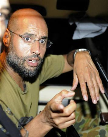 A file photo shows Saif al-Islam, the son of Libyan leader Muammar Gaddafi, speaking to reporters in Tripoli August 23, 2011. REUTERS/Paul Hackett/Files