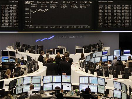 Traders are pictured at their desks in front of the DAX board at the Frankfurt stock exchange October 27, 2011. REUTERS/Remote/Kirill Iordansky