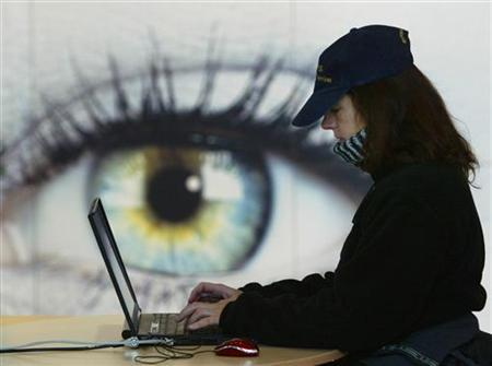 A women uses her laptop at the booth of IBM at the world's largest computer fair CeBIT in Hanover March 9, 2005. TECOM REUTERS/Fabrizio Bensch