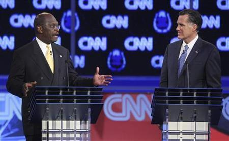 Former Massachusetts Governor Mitt Romney listens as businessman Herman Cain  (R) speaks as they take part in the CNN Western Republican debate in Las Vegas, Nevada October 18, 2011.       REUTERS/Steve Marcus