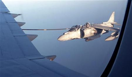 An Italian Harrier war plane refuels from a British VC-10 tanker aircraft over the Mediterranean Sea off Libya July 10, 2011.   REUTERS/David Brunnstrom