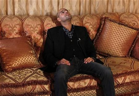 Libyan leader Muammar Gaddafi's son Saif al-Islam pauses during an interview with Reuters in Tripoli, March 10, 2011.     REUTERS/Chris Helgren