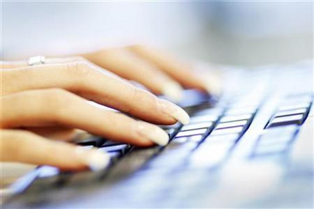 A woman uses a computer keyboard in this photo illustration taken in Sydney June 23, 2011. REUTERS/Tim Wimborne