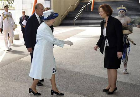 Britain's Queen Elizabeth greets Australian Prime Minister Julia Gillard as she arrives for the opening ceremony at the Commonwealth Heads of Government Meeting (CHOGM) in Perth October 28, 2011. REUTERS/Dean Lewins/Pool
