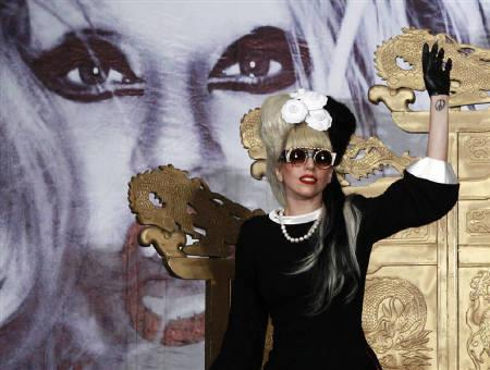 U.S. singer Lady Gaga waves as she arrives for a news conference in Taipei in this July 4, 2011 file photo. Lady Gaga is set to perform at an invitation-only show in a five-star hotel club in New Delhi after the F1 race on Sunday. REUTERS/Nicky Loh/Files