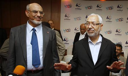 Rachid Ghannouchi (R), the leader of the Islamist Ennahda party, and his secretary-general Hamadi Jbeli attend a news conference in Tunis October 28, 2011. REUTERS/Zoubeir Souissi