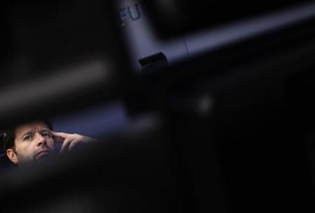 A trader reacts at his desk at the Frankfurt stock exchange October 27, 2011. REUTERS/Alex Domanski