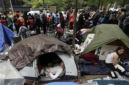 Occupy Wall Street protestors relax in tents in New York's Zucotti Park, October 24, 2011.  REUTERS/Brendan McDermid