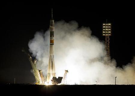 The Russian Soyuz TMA-02M spacecraft, carrying the International Space Station (ISS) crew of Japanese astronaut Satoshi Furukawa, Russian cosmonaut Sergey Volkov and U.S. astronaut Michael Fossum, blasts off from its launchpad at the Baikonur cosmodrome, June 8, 2011.  REUTERS/Shamil Zhumatov