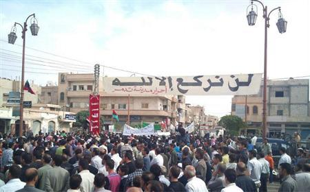 Demonstrators protest against Syria's President Bashar al-Assad after Friday prayers in the ancient city of Palmyra October 28, 2011.  REUTERS/Handout