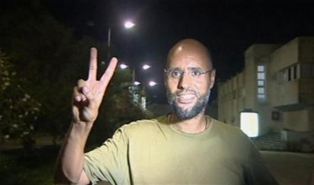 Saif Al-Islam, son of Libyan leader Muammar Gaddafi, gestures in Tripoli August 23, 2011 in this still image taken from video. REUTERS/Reuters TV